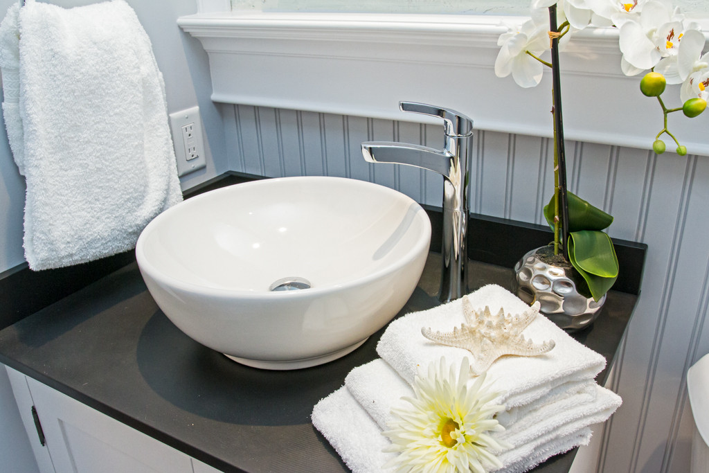 beautifully staged bathroom counter with bowl sink and towels