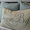 pillow with dream big wording staging